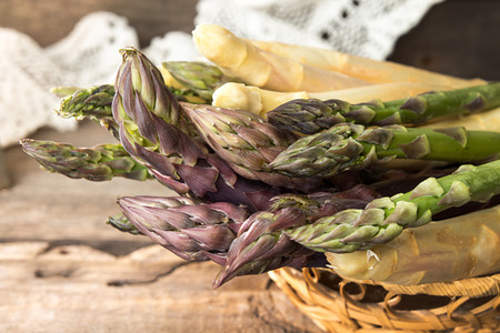 Set of raw white, green, purple asparagus on old wooden rustic  background. Close up. Stok Fotoğraf