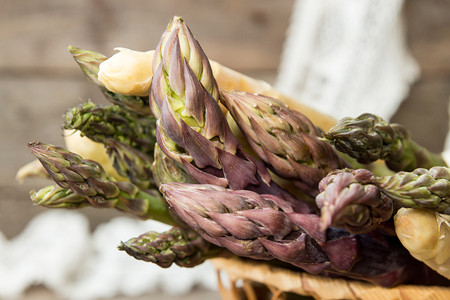 Set of raw white, green, purple asparagus on old wooden rustic  background. Close up. Reklamní fotografie