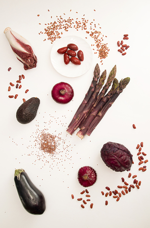Set collection of red purple fresh organic vegetables on white background. Flat lay. Overhead.