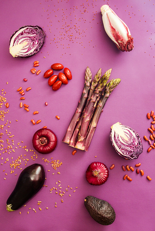 Set collection of red purple fresh organic vegetables on purple background. Flat lay. Overhead. Stok Fotoğraf