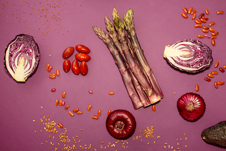 Set collection of red purple fresh organic vegetables on purple background. Flat lay. Overhead. Reklamní fotografie