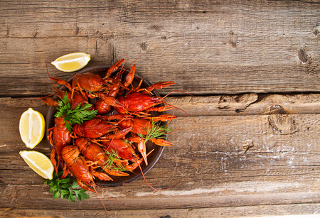 Boiled cooked crayfish crawfish ready to eat onold rustic wooden background. Copy space. Overhead. Top view. Stok Fotoğraf