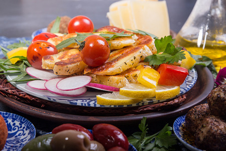 Grilled roasted halloumi cheese with grilled cherry tomato, pepper, zuccini. Tasty snack overhead.