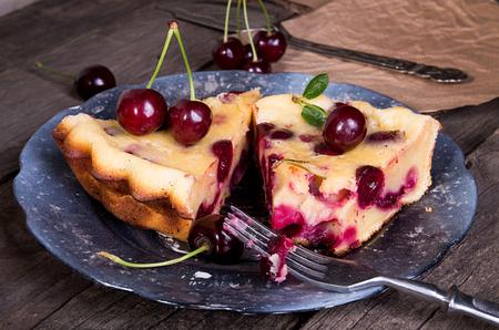 Piece of sweet cherry clafouti. Summer pie. Stock Photo