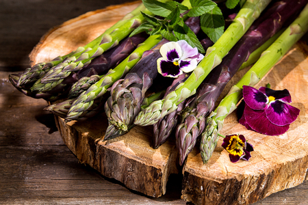 Set of raw white, green, purple asparagus on old wooden rustic  background. organic healthy eating concept. 版權商用圖片