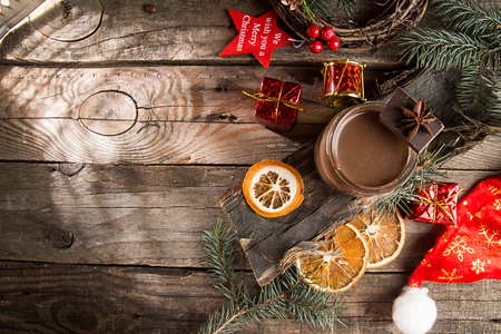 Jar of hot chocolate and Christmas decorations.Copy space. Top view.Rustic wooden background.