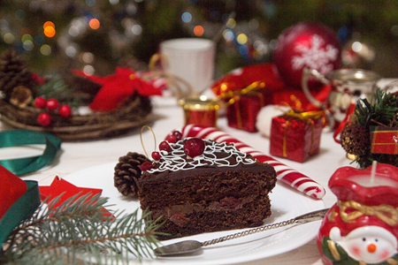 Slice of sweet chocolate cake for Christmas Eve.