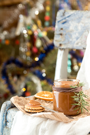 Jar of salt caramel and Christmas New Year decorations. 版權商用圖片