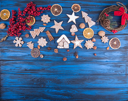 Christmas New Year background with gingerbread cookies. Top view. Copy space.