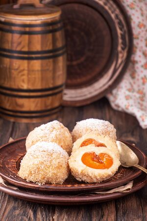 Austrian and czech sweet dessert apricot dumplings. Filled cottage cheese dough. Imagens