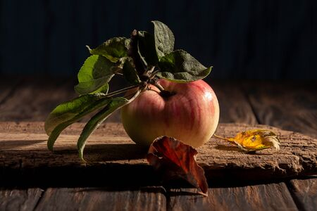 Organic natural apple on wooden background.