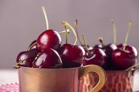 Fresh sweet cherry in cooper cup