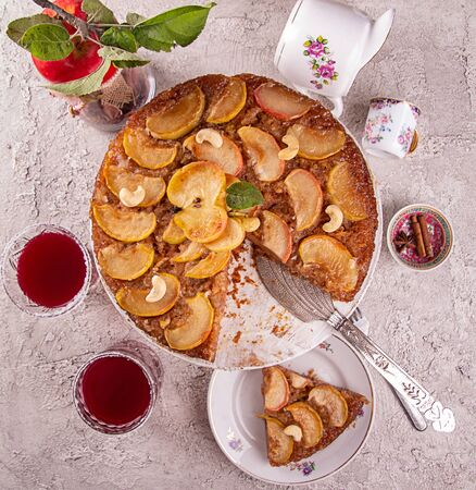 French sweet pie tart tatin apple cake upside down  over on gray concrete background. Top view