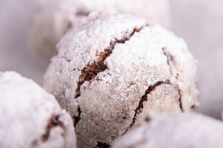 Traditional Christmas almond chocolate snowballs cookies biscuits covered icing sugar powder. Russian Tea Cakes, Mexican Wedding Cookies, Butterballs. Close up