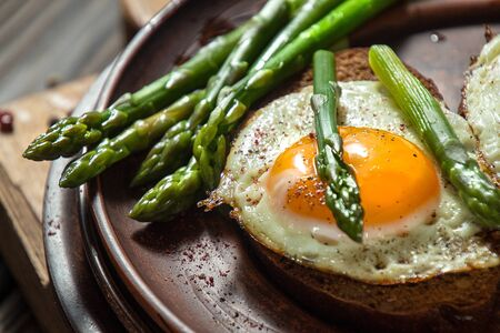 Delicious toast bread sandwiches with asparagus and fried eggs.