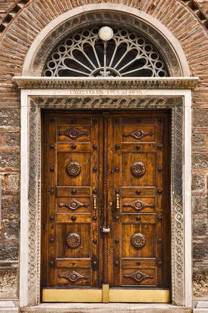 Wooden church door, Athens, Greece photo
