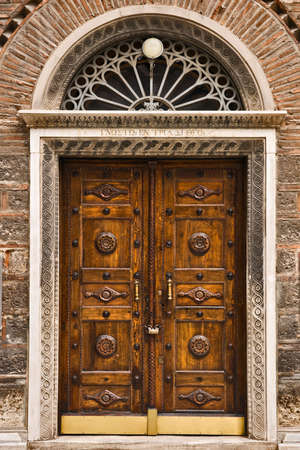 Wooden church door, Athens, Greece photo