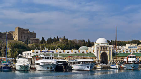 Panoramic view of Palace of the Grand Masters and Mandraki port, Rhodes, Greece