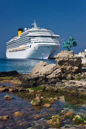 Cruise liner next to Rhodes sea coast, Greece