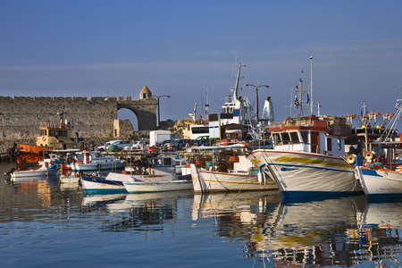 seacoast: Fishing boats in Rhodes harbor at sunset, Greece