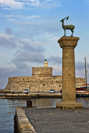 Lighthouse and deer statue in Mandraki harbor, where the Colossus of Rhodes once stood, Greece