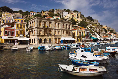Boats at harbor of Symi, Greece Stock Photo