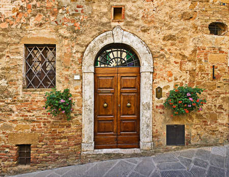 Old house door, Pienza, Tuscany, Italy Stock Photo
