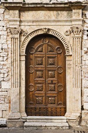 wood carving door: Torre del Popolo door, Assisi, Umbria, ItalyTorre del Popolo door, Assisi, Umbria, Italy