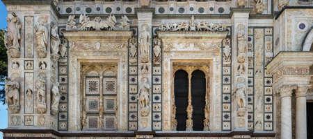 gothic window: Rich decorated church façade, Certosa di Pavia monastery complex, Italy