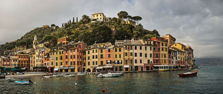 Panoramic view over picturesque harbor of Portofino, an Italian fishing village and upmarket resort
