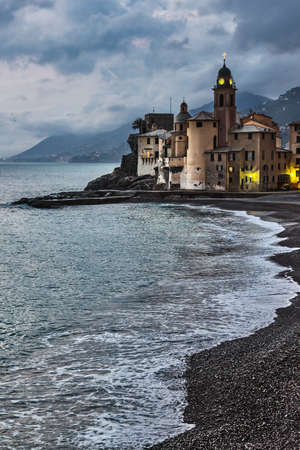 Camogli - is a small Italian fishing village and tourist resort, located on the west side of the peninsula of Portofino, Italian Riviera, Liguria, Italy