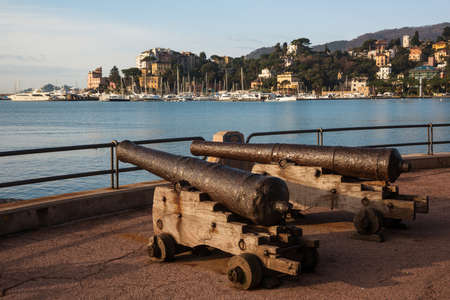 Medieval cannons in Rapallo is resort town in the Tigullio Gulf, the province of Genoa, Liguria, Italy Stock Photo