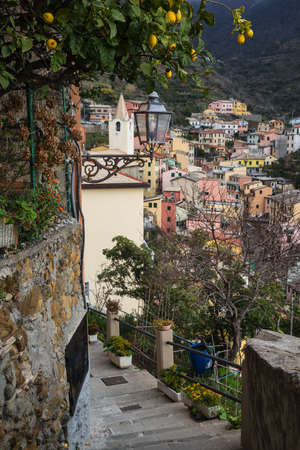 Scenic bystreet in Riomaggiore, a village and comune in the province of La Spezia in the Liguria region of Italy  It is the one of the Cinque Terre villages  Stock Photo