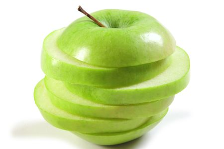 Sliced green apple with dropped shadow on white. Stock Photo