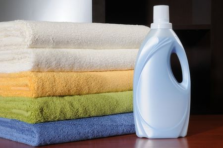Clean laundry and detergent bottle. Stock Photo - 4286633