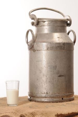 old container: Old milk container with glass. Stock Photo