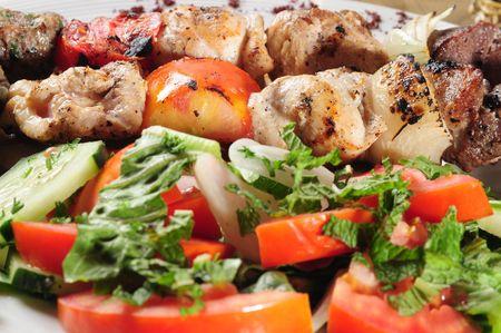 shish kebab: Salad and shish kebab. Stock Photo