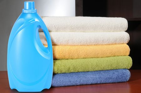 Detergent bottle and towels. photo