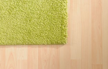 Carpet floor: Green carpet on wooden floor Stock Photo