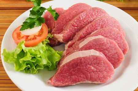 Raw meat and salad photo