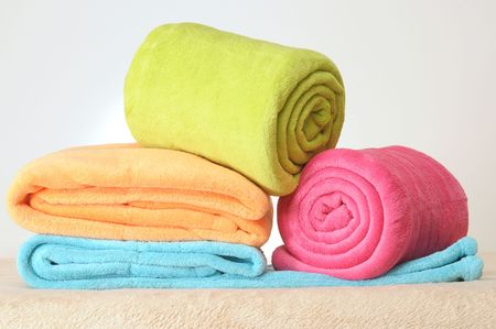 absorb: Towels on blanket Stock Photo