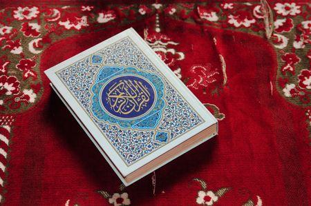 Koran on praying carpet photo
