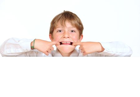 Cheeky boy behind message board. Stock Photo - 5646600