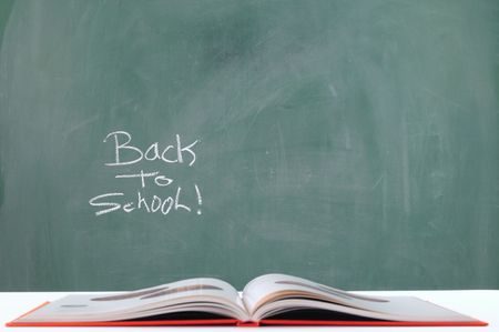back in time: Teacher`s book. Focus on chalkboard. Stock Photo