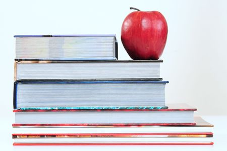 Red apple on books. photo