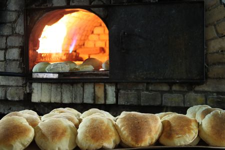 bakery oven: Baking Pita bread Stock Photo