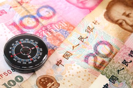 Compass on chinese currencies. photo