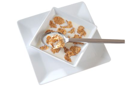 Milk and cereal. Isolated photo