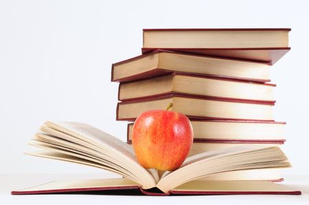 Apple and books. Stock Photo