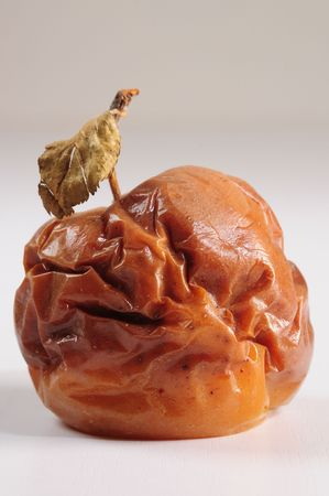 rotten fruit: Rotten apple. Conceptual. Stock Photo